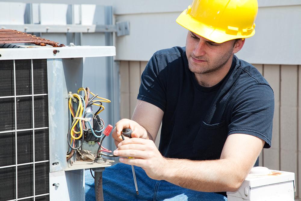 HVAC energy efficiency worker