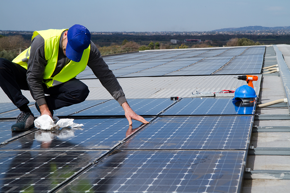 solar pv worker on roof