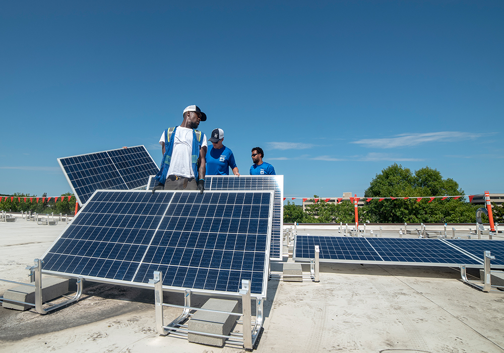 IPS Solar workers on roof