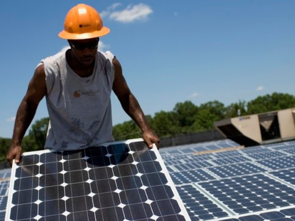 worker with solar panels