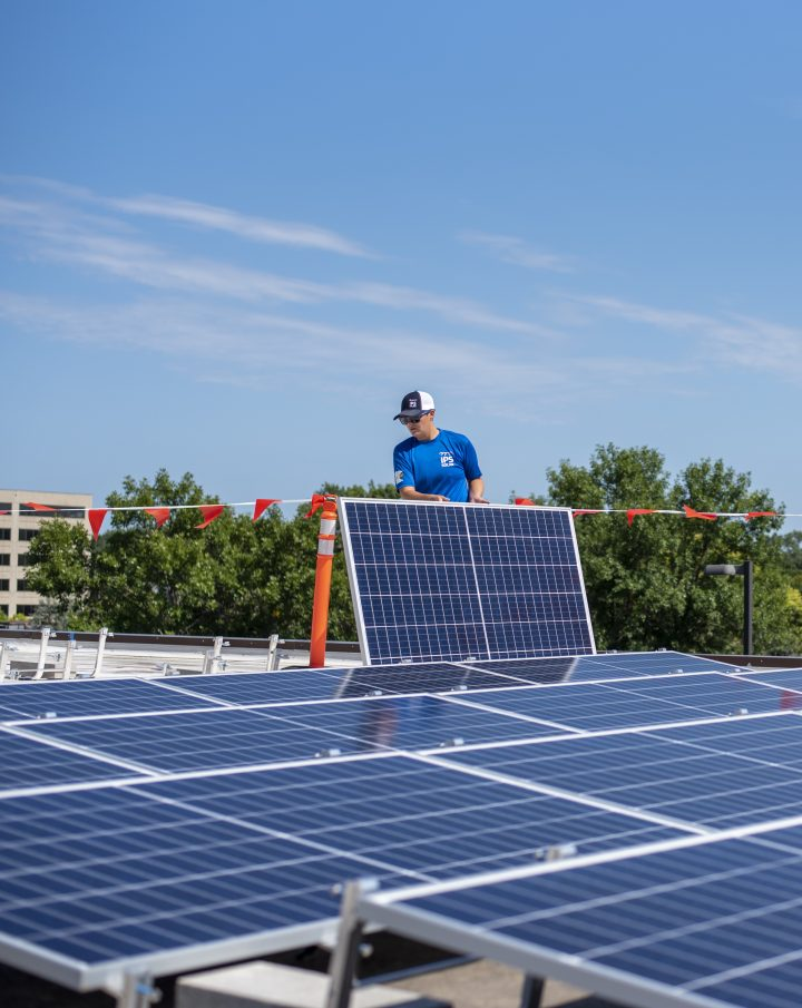 IPS Solar installer on rooftop