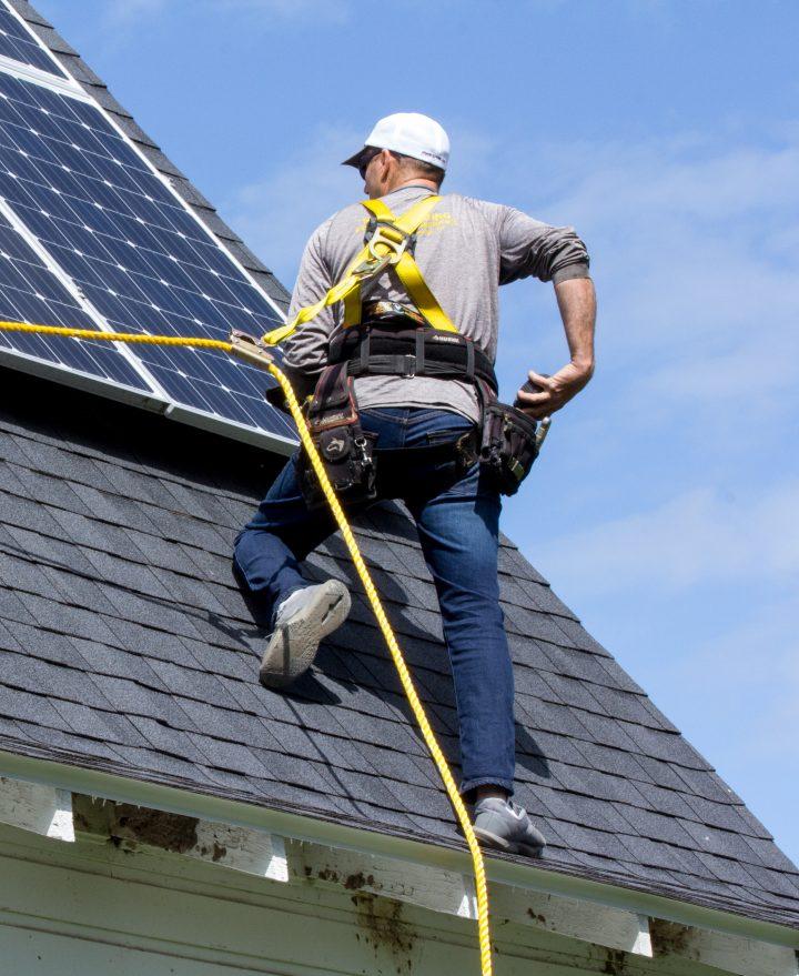 all energy solar worker on barn