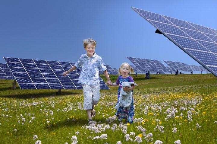 Children playing near solar panels