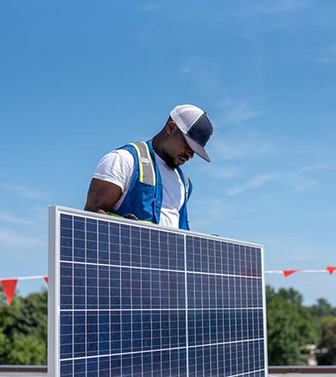 ips solar worker on rooftop